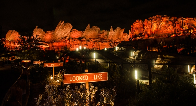 Cars Land Cadillac Mountains and signs night